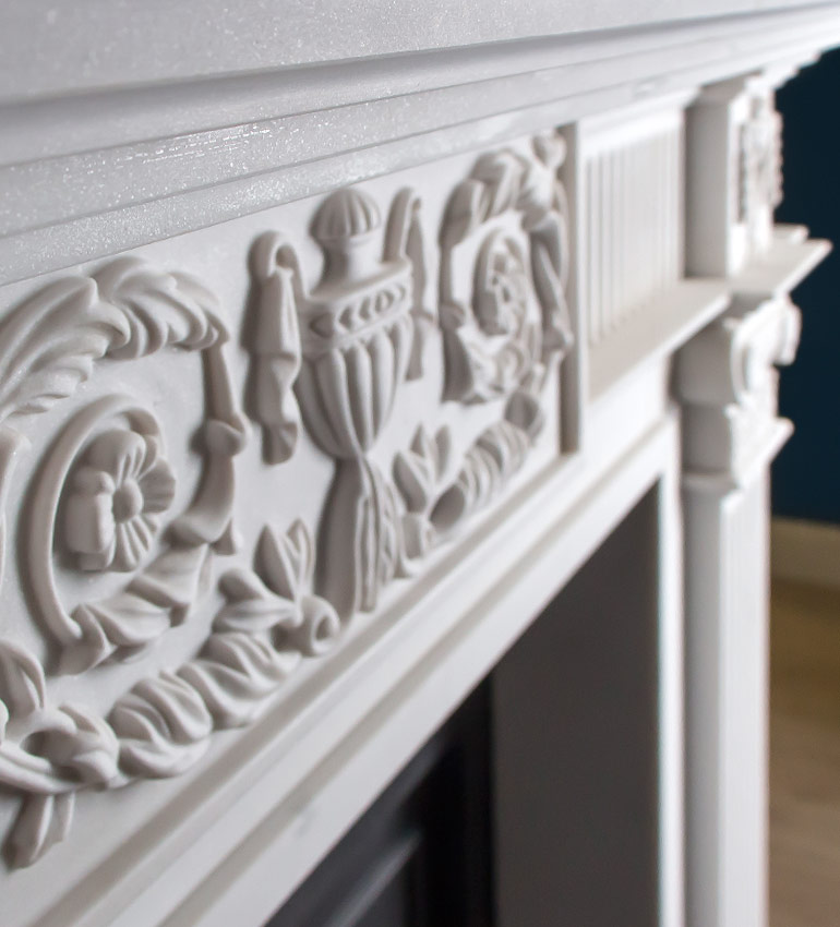 Beautiful stone carved detail in period fireplace