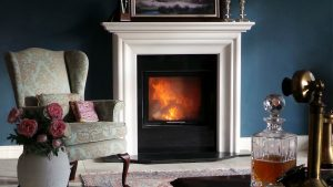 Elegant stone fireplace in white marble at Buckley Fireplaces showroom in Dublin 18