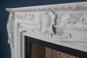 Victorian Fireplace Close Up white marble central emblem feathers and horse