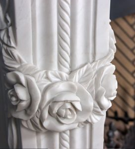 stone rose detail on buckleys stone fireplace